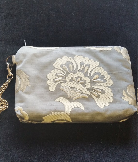 B608.  Embroidered flower clutch