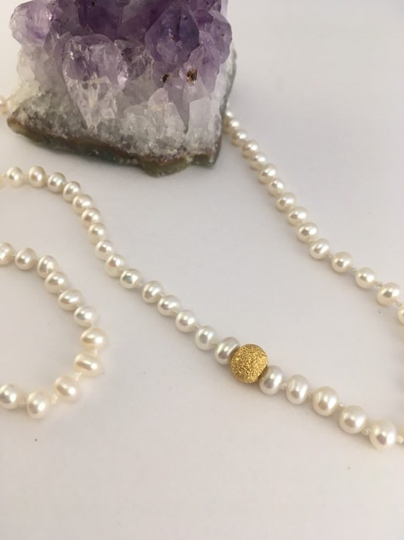 S - 784 Pearl necklace featuring sterling silver stardust bead