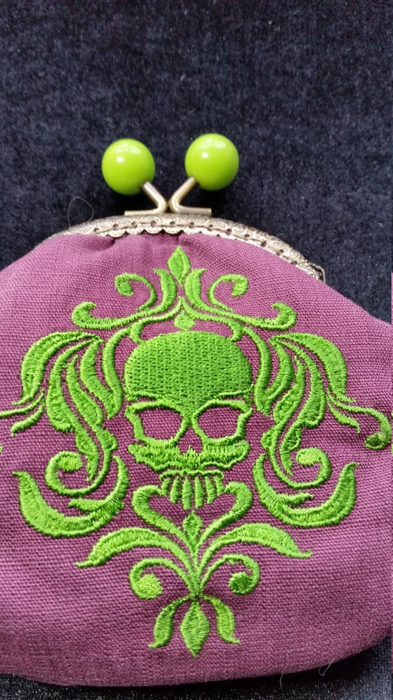L129A.  Coin purse with baroque skull design