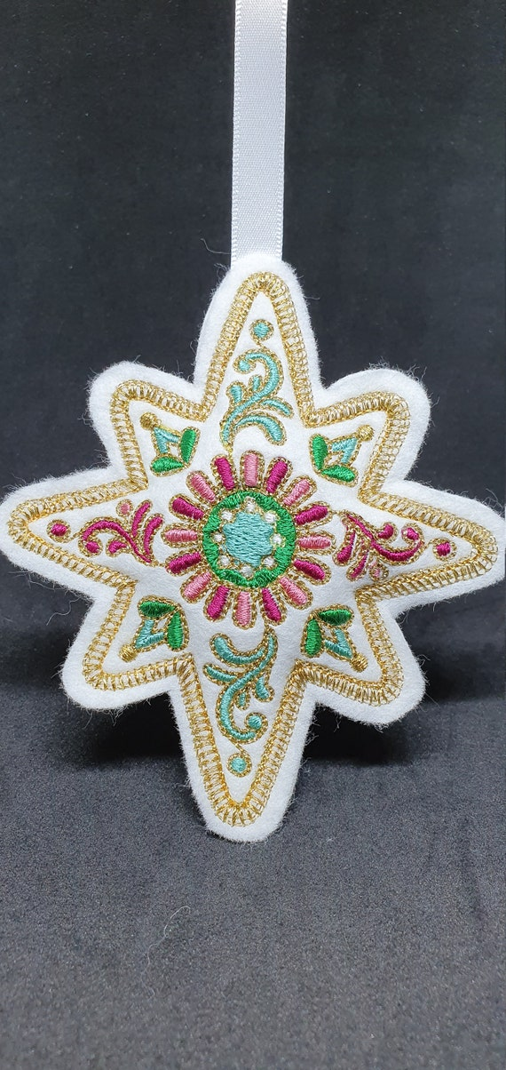 X052.   Festive filigree Christmas ornament - Star