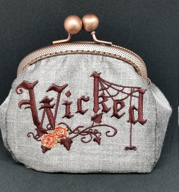 CP583.       Wicked design coin purse.