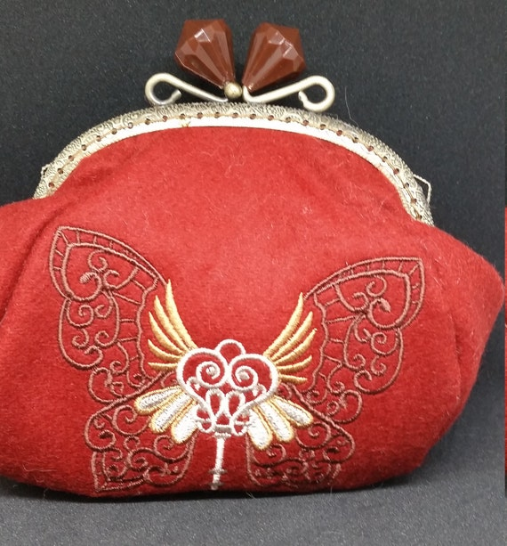 CP588.    Intrepid journey. Winged wonder design coin purse.