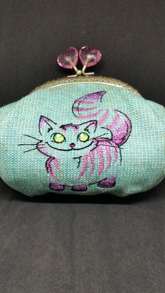 CP650.   The cheshire cat design large coin purse.