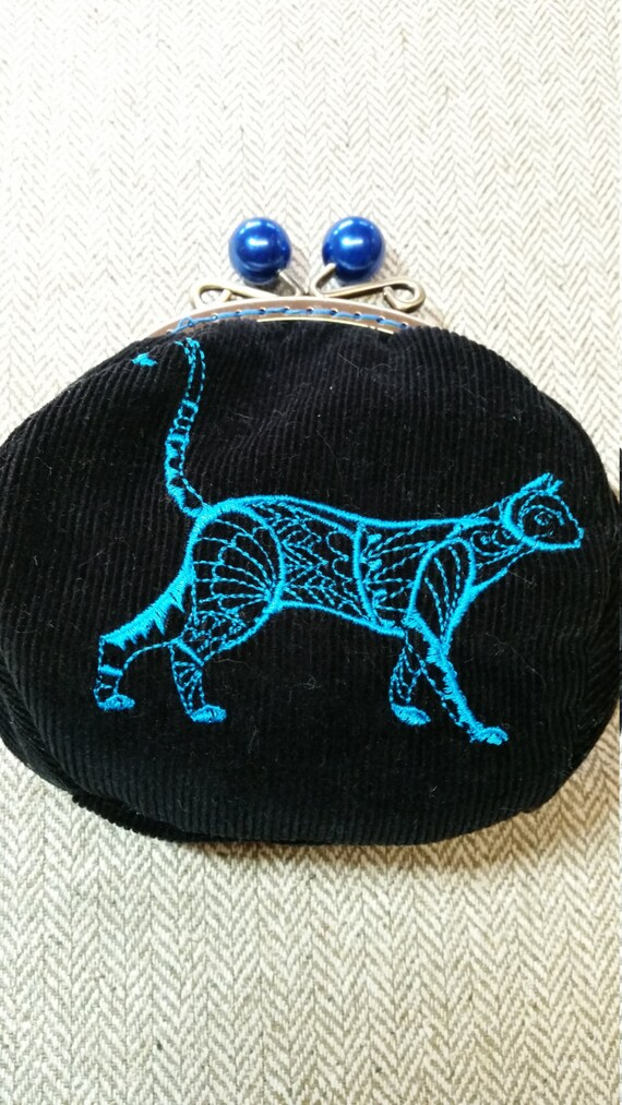 L506.  Coin purse with tuxedo cat design