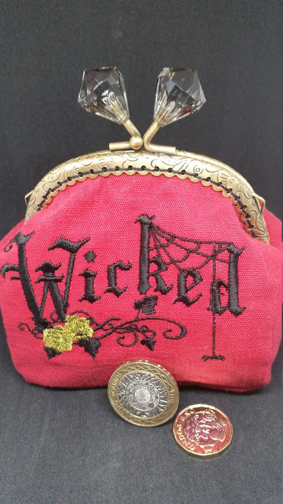 CP631.  The red wicked design coin purse.