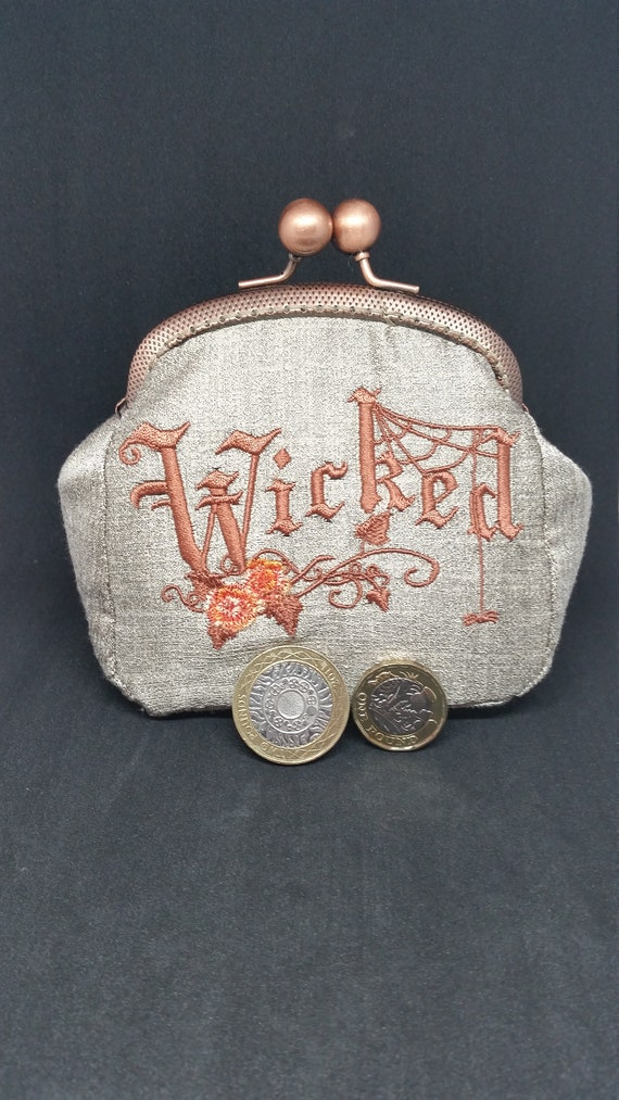 CP637.  The bronze wicked design coin purse.