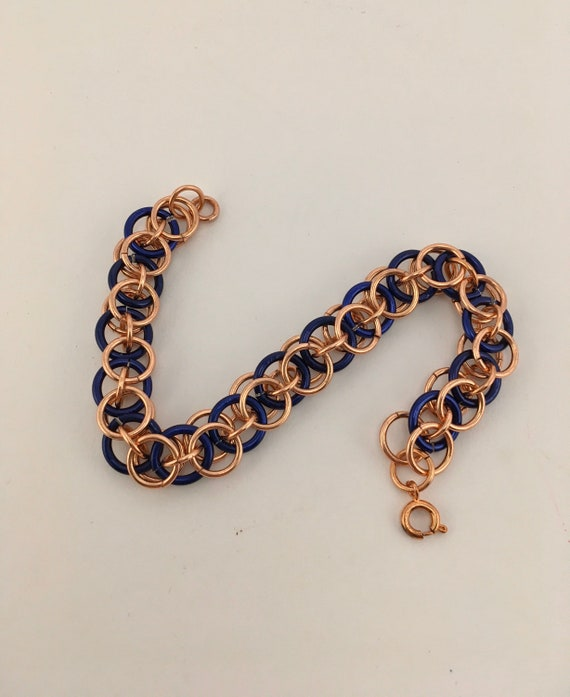 SB - 001 Chainmaille bracelet in blue and rose gold colours.