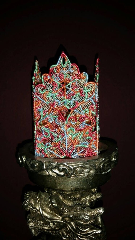 H014.    Tealight holder in multiple colours.