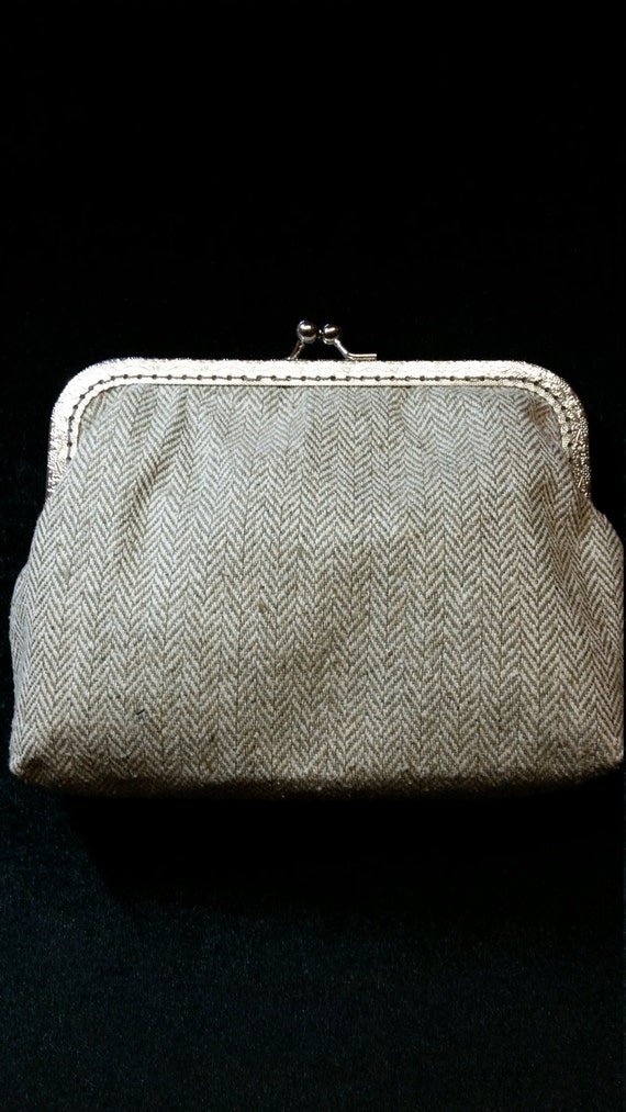 B505.  Clutch bag in pale green  herringbone tweed.