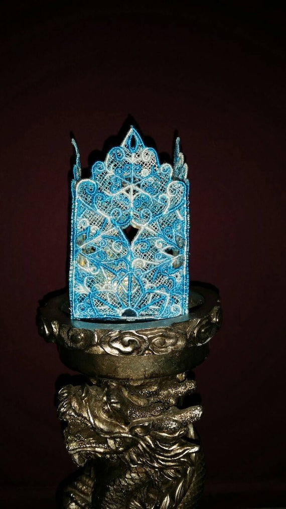 H013.  Tealight holder in multiple colours of blue and white