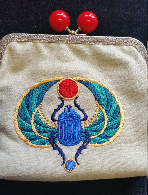 CP555. Coin purse with Egyptian scarab design.