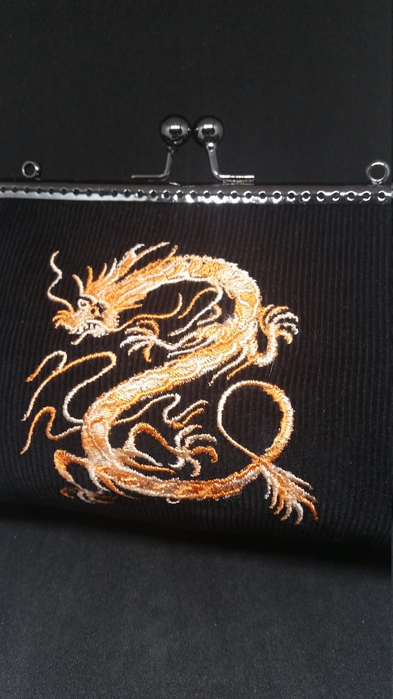 B659.  Small clutch bag with Mythical dragon design