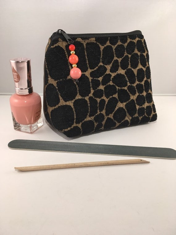 S - 890 Small make up/coin purse featuring animal print