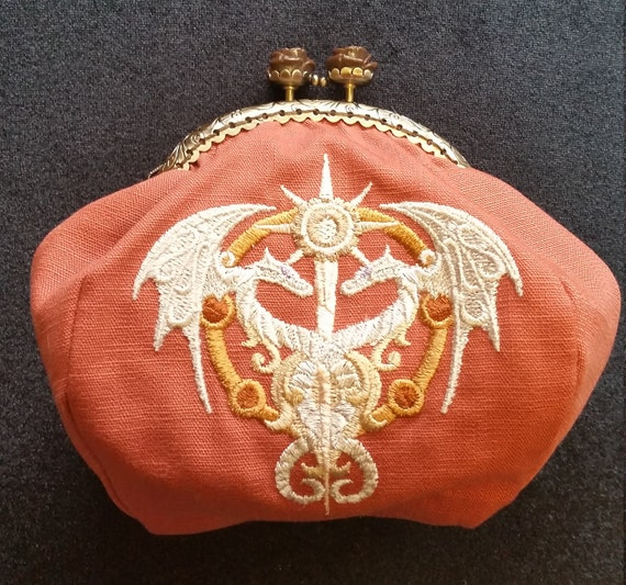 CP554. Coin purse with steampunk alchemy caduceus design.