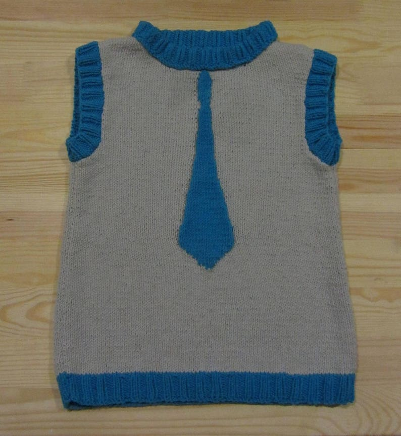 Knitted vest with a tie for a boy.
