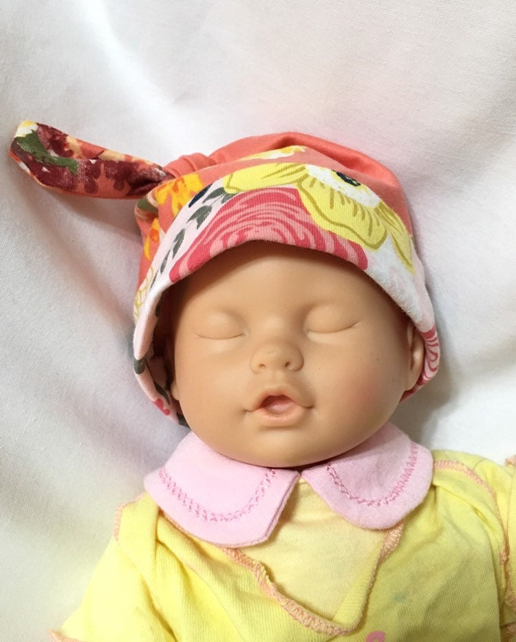 555ae9687ee Peach Floral Baby Knit Fabric Hat