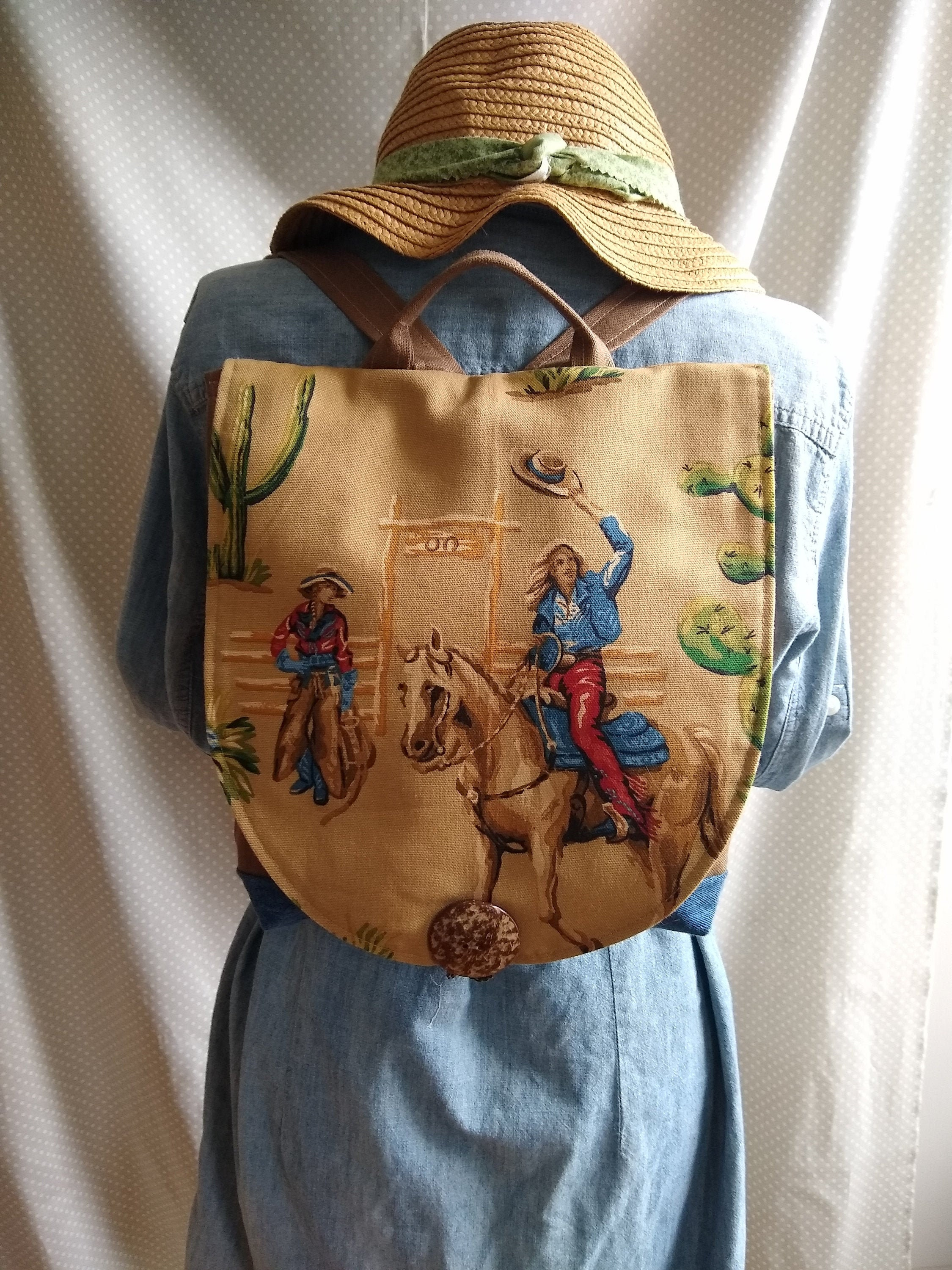 Backpack. Fun and Beautiful. Designer fabrics, quality construction, unique, cowgirls, tan, brown, vintage, horse, front flap.