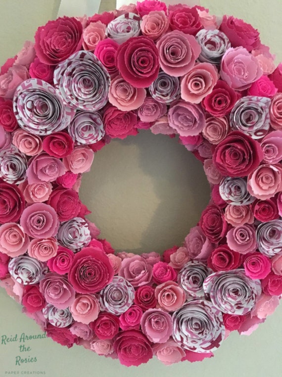 Book flower wreath done in two tone pink flowers with greenery accents Breast Cancer Awareness