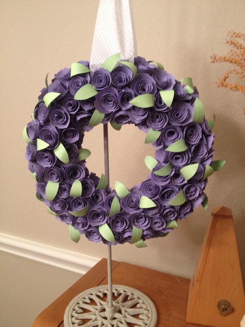 Paper flowersPurple paper flowersgreen paper leavesPurple paper rosespurple paper wreathpaper flower wreathpurple paper flower decor