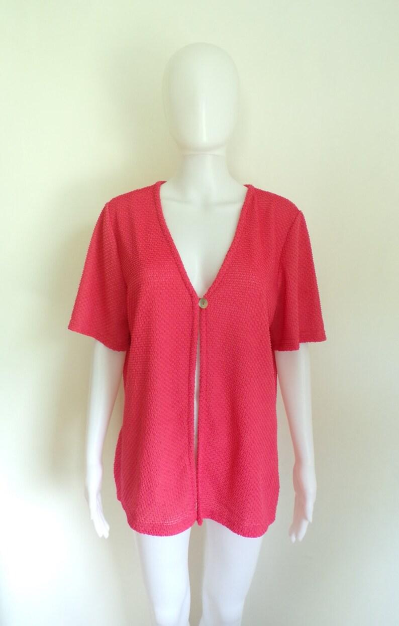 salmon pink 80s knit jacket size medium lightweight short sleeve jacket 1980s jacket open front eyelet details