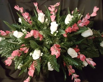 Tombstone Saddle Made with White Roses and Glads