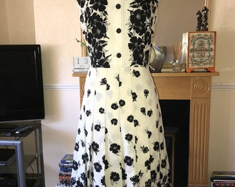 Vintage 1970s cream and black floral dress with pleated skirt