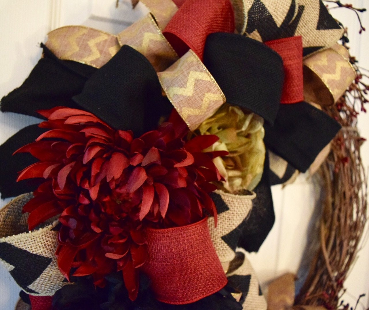 Salzburg Creations Burgundy And Rose Gold Fireworks: Grapevine Wreath With Burgundy, Black And Gold Ribbons And