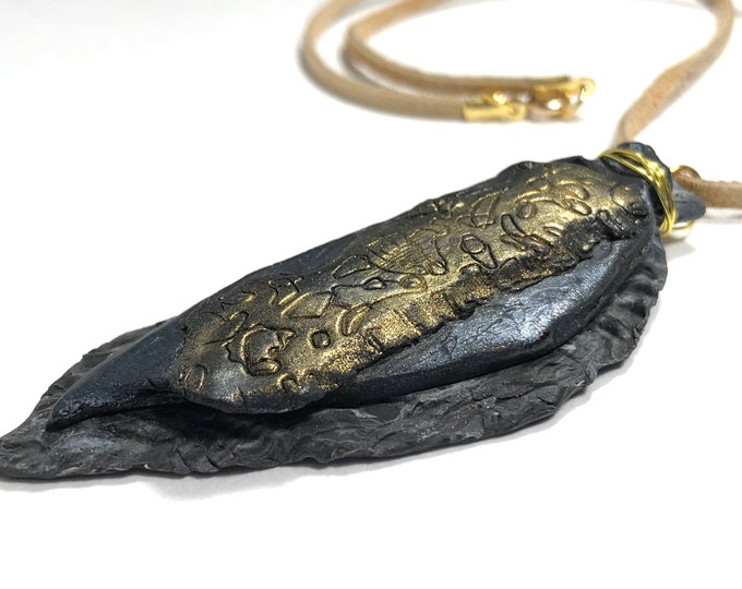 Arrowhead Shaped Pendant Necklace, Black and Gold