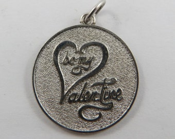 A Sterling Silver Charm asking Be My Valentine.