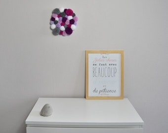 Wall decoration in purple, grey and white PomPoms