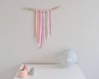 Pink, white and beige wall decor