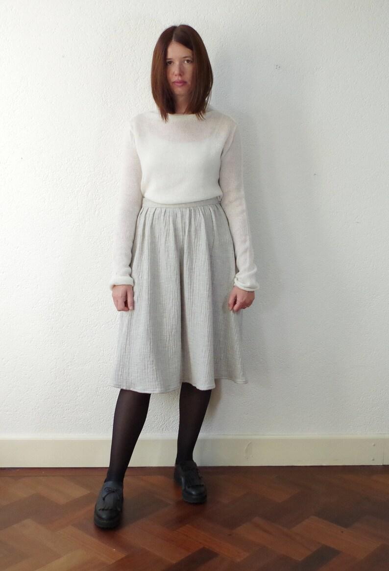 Skirt. Gray cotton gauze gathered skirt. High waist flared image 0
