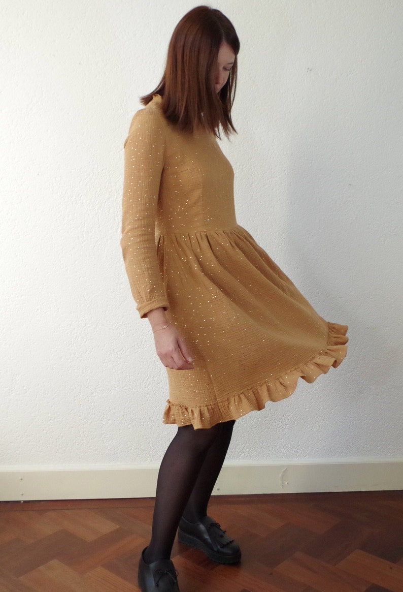 Gathered dress with frills. Ocher cotton gauze with gold polka image 0