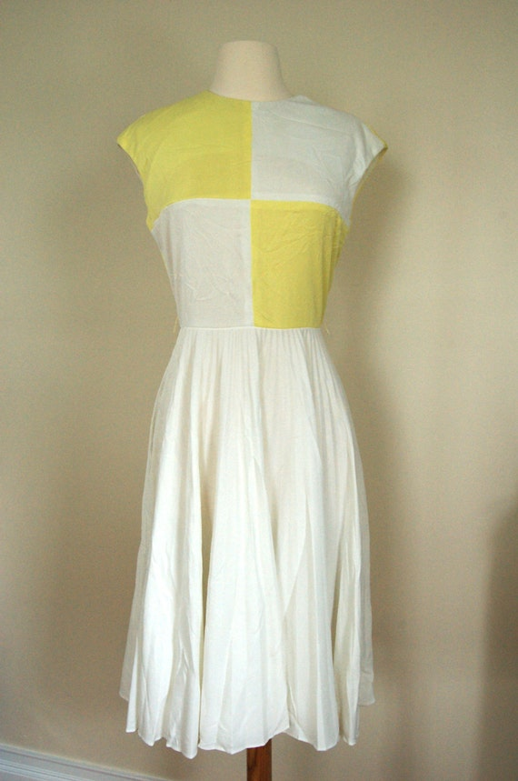 Vintage white yellow check 60's dress with a white pleated circle skirt zip up back crew neck sleeveless cap sleeve cinched waist tea length