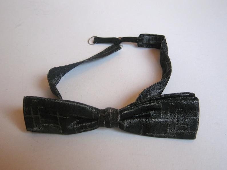 vintage silver tone brocade bow