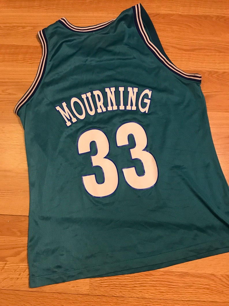check out 8c267 be2d9 Vintage champion Alonzo mourning charlotte hornets jersey size 48 XL