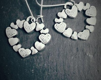 Unusual Love Heart Silver Plated Drop Earrings
