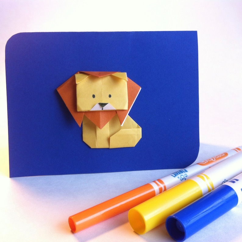 Greeting card  Lion in origami blue background perfect for image 0
