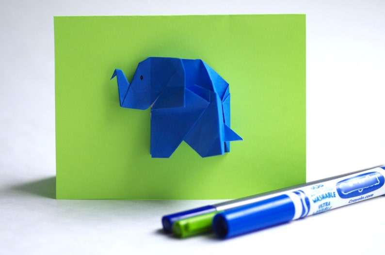 Greeting card elephant theme. Blue Elephant in origami on the image 0