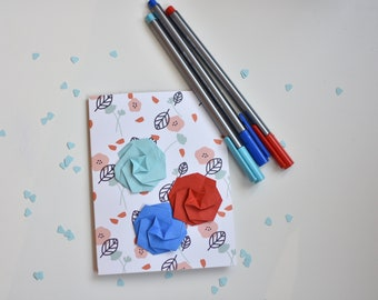 Origami greeting card with three flowers red and blue. Origami card. Original flowers illustration for background.