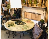 Bistro round table, vintage iron base, wood top decoupaged & glazed, includes pair vintage chairs