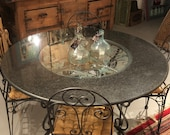 Italian Wrought Iron with Granite/Glass Table, four chairs, grape/grape leaf motif.  Free Aldie VA pickup.  Shipping extra