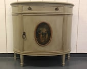 SOLD*Antique French Demilune Table cabinet, original center artwork, painted.  Local Aldie VA pickup.  Shipping Extra