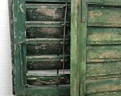 Pair of Antique European shutters, green