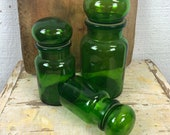 Set of three green vintage pharmacy jars, European