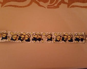 Pacifier clip with a yellow heart