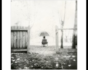 Under umbrella. Silver gelatin print from paper negative.