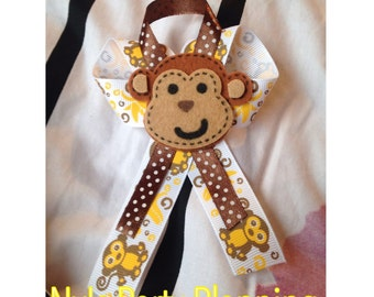 Mini monkey diaper cake with 6 matching guest pins