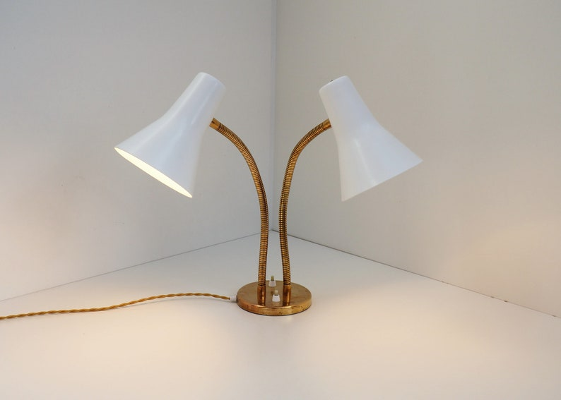 Remarkable two headed table lamp in brass and white metal shades Danish vintage design from the 1950s