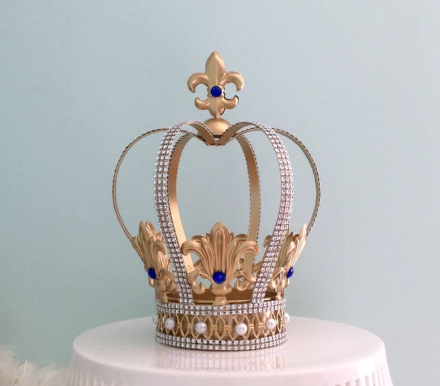 big gorgeous gold crown cake topper with royal blue crystals for